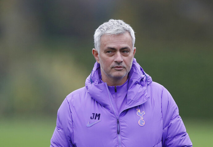 Tottenham Hotspur's manager Jose Mourinho watches his players during a training session at their training ground in London, Monday Nov. 25, 2019, ahead of their Champions League Group B soccer match against Olympiakos on Tuesday. (AP Photo/Alastair Grant)