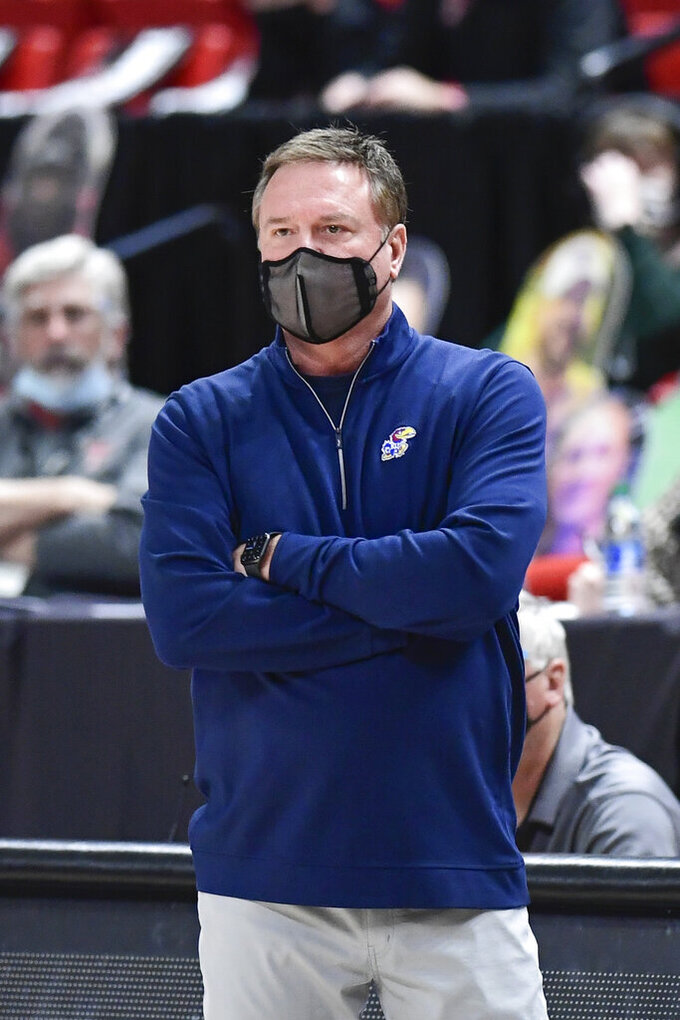 Kansas head coach Bill Self watches from the sideline during the first half of an NCAA college basketball game against Texas Tech in Lubbock, Texas, Thursday, Dec. 17, 2020. (AP Photo/Justin Rex)