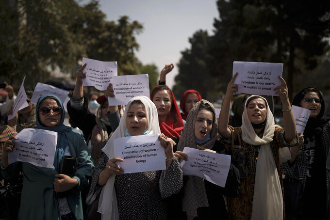 Afghan women march to demand their rights under the Taliban rule during a demonstration near the former Women's Affairs Ministry building in Kabul, Afghanistan, Sunday, Sept. 19, 2021. The interim mayor of Afghanistan's capital said Sunday that many female city employees have been ordered to stay home by the country's new Taliban rulers. (AP Photo)
