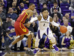 Washington's David Crisp (1) races past Southern California's Shaqquan Aaron during the second half of an NCAA college basketball game Wednesday, Jan. 30, 2019, in Seattle. Washington won 75-62. (AP Photo/Elaine Thompson)