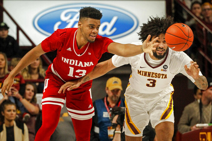 Indiana's Juwan Morgan (13) and Minnesota's Jordan Murphy (3) battle for a loose ball in the first half of an NCAA college basketball game Saturday, Feb. 16, 2019, in Minneapolis. (AP Photo/Bruce Kluckhohn)
