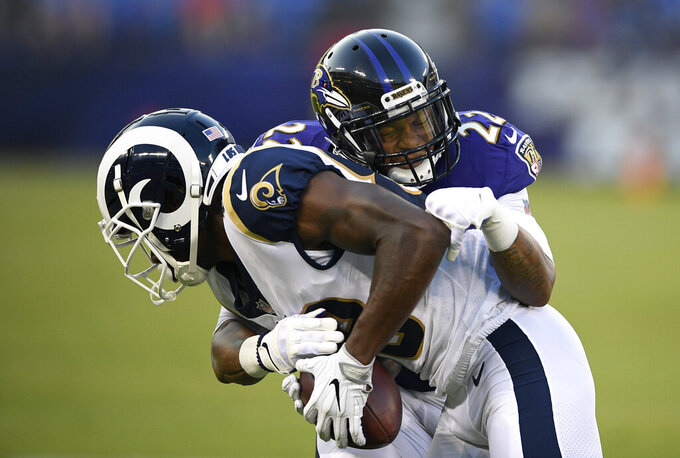 FILE - In this Aug. 9, 2018, file photo, Baltimore Ravens defensive back Jimmy Smith (22) tackles Los Angeles Rams wide receiver Mike Thomas in the first half of a preseason NFL football game, in Baltimore. Back in action after yet another injury, Ravens cornerback Jimmy Smith hopes to be an integral part of the Baltimore defense over the final half of the season. (AP Photo/Nick Wass, File)