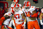 Clemson's Tyler Davis (13) celebrates a fumble recovery with teammates James Skalski (47) and K'Von Wallace (12) during the first half of an NCAA college football game against North Carolina State in Raleigh, N.C., Saturday, Nov. 9, 2019. (AP Photo/Karl B DeBlaker)