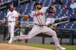 Atlanta Braves starting pitcher Huascar Ynoa throws during the first inning of baseball game against the Washington Nationals at Nationals Park, Tuesday, May 4, 2021, in Washington. (AP Photo/Alex Brandon)