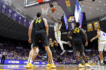 LSU forward Emmitt Williams (5) drives to the basket as Missouri's forward Reed Nikko (14), guard Dru Smith (12) and forward Kobe Brown (24) watch in the first half of an NCAA college basketball game, Tuesday, Feb. 11, 2020, in Baton Rouge, La. (AP Photo/Bill Feig)