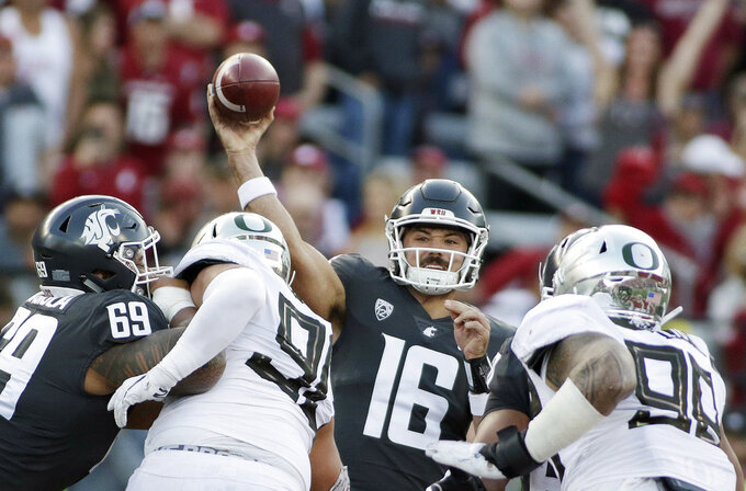 Washington State quarterback Gardner Minshew (16) throws a pass during the first half of an NCAA college football game against Oregon in Pullman, Wash., Saturday, Oct. 20, 2018. (AP Photo/Young Kwak)