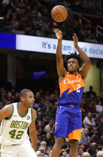 Cleveland Cavaliers' Collin Sexton (2) shoots over Boston Celtics' Al Horford (42) in the second half of an NBA basketball game, Tuesday, March 26, 2019, in Cleveland. Boston won 116-106. (AP Photo/Tony Dejak)