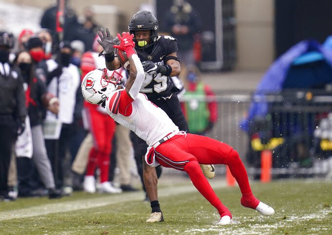 Utah wide receiver Bryan Thompson pulls in a pass as Colorado cornerback Mekhi Blackmon defends in the second half of an NCAA college football game Saturday, Dec. 12, 2020, in Boulder, Colo. Utah won 38-21. (AP Photo/David Zalubowski)