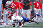Tulsa defensive back Tyon Davis, bottom, tackles Ohio State running back Master Teague (33) during the first half of an NCAA college football game Saturday, Sept. 18, 2021, in Columbus, Ohio. (AP Photo/Jay LaPrete)