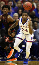 Kansas guard Lagerald Vick (24) steals the ball from Stanford guard Daejon Davis (1) during the first half of an NCAA college basketball game in Lawrence, Kan., Saturday, Dec. 1, 2018. (AP Photo/Orlin Wagner)