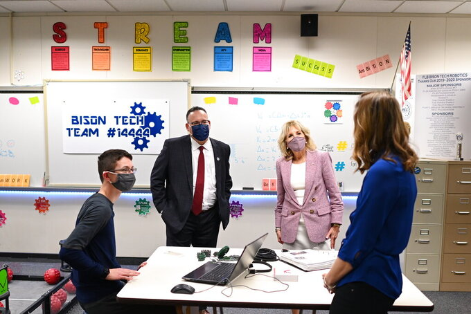 First lady Jill Biden and Education Secretary Miguel Cardona visit a robotics lab during a tour at Fort LeBoeuf Middle School in Waterford, Pa., Wednesday, March 3, 2021. (Mandel Ngan/Pool via AP)