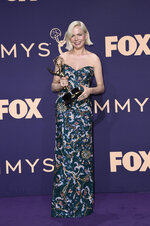 Michelle Williams poses in the press room with the award for outstanding lead actress in a limited series or movie for