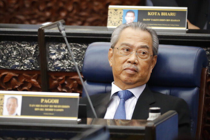 Malaysian Prime Minister Muhyiddin Yassin attends a parliament session at lower house in Kuala Lumpur, Malaysia, on July 13, 2020. Muhyiddin said Monday, Oct. 26, 2020 his government was prioritizing protecting people from COVID-19 amid a new outbreak after the king rejected an emergency proposal that critics saw as an undemocratic attempt to hold onto power. (AP Photo/Vincent Thian)