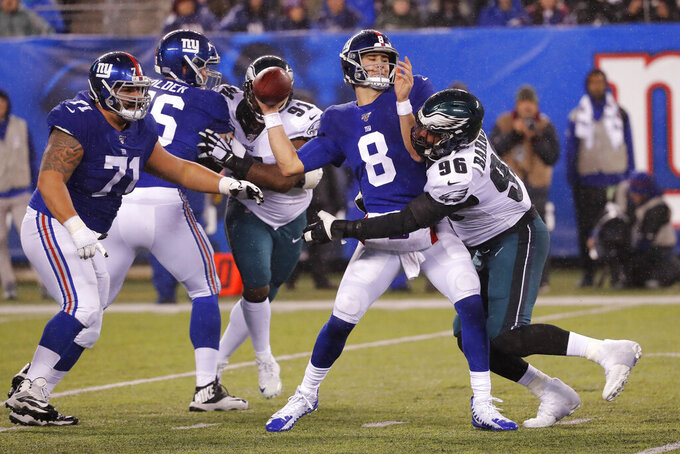 New York Giants quarterback Daniel Jones (8) looks to pass as he is sacked by Philadelphia Eagles defensive end Derek Barnett (96) in the second half of an NFL football game, Sunday, Dec. 29, 2019, in East Rutherford, N.J. (AP Photo/Seth Wenig)