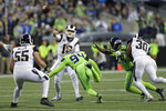 Los Angeles Rams quarterback Jared Goff, center, passes under pressure from Seattle Seahawks defensive end Ziggy Ansah (94) during the first half of an NFL football game Thursday, Oct. 3, 2019, in Seattle. (AP Photo/Stephen Brashear)