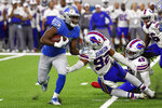 Detroit Lions running back Kerryon Johnson (33) avoids the tackle of Buffalo Bills defensive end Darryl Johnson (92) during the first half of an NFL preseason football game in Detroit, Friday, Aug. 23, 2019. (AP Photo/Rick Osentoski)