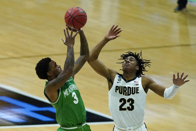 North Texas's Javion Hamlet (3) shoots against Purdue's Jaden Ivey (23) during the second half of a first-round game in the NCAA men's college basketball tournament at Lucas Oil Stadium, Friday, March 19, 2021, in Indianapolis. (AP Photo/Darron Cummings)