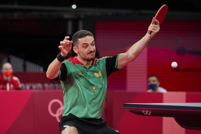Portugal's Marcos Freitas competes during the table tennis men's singles third round match against Austria's Daniel Habesohn at the 2020 Summer Olympics, Monday, July 26, 2021, in Tokyo. (AP Photo/Kin Cheung)