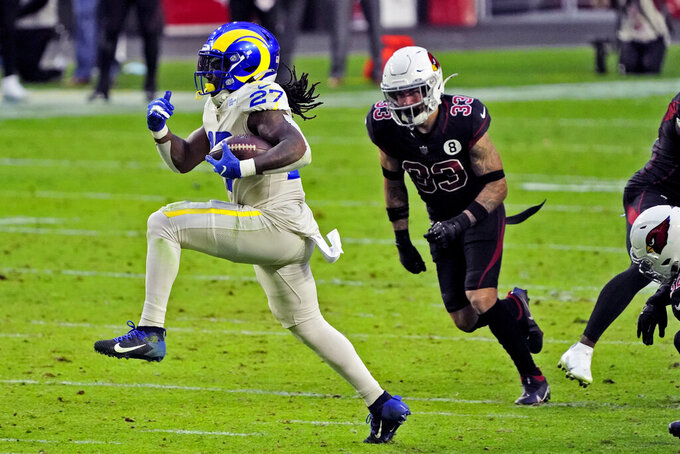 Los Angeles Rams running back Darrell Henderson (27) breaks free for a touchdown as Arizona Cardinals cornerback Byron Murphy (33) pursues during the second half of an NFL football game, Sunday, Dec. 6, 2020, in Glendale, Ariz. (AP Photo/Rick Scuteri)