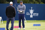 Sami Valimaki, of Finland, talks with his swing coach while practicing for the U.S. Open Championship golf tournament, Tuesday, Sept. 15, 2020, at the Winged Foot Golf Club in Mamaroneck, N.Y. (AP Photo/Charles Krupa)