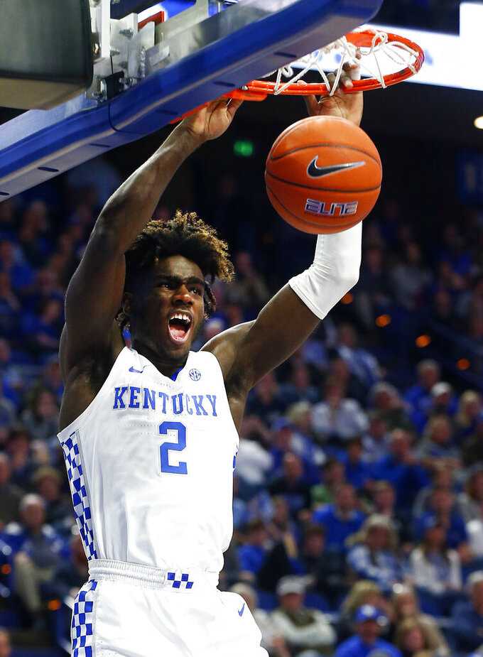 Kentucky's Kahlil Whitney dunks during the second half of an NCAA college basketball game against Mount St. Mary's in Lexington, Ky., Friday, Nov. 22, 2019. Kentucky won 82-62. (AP Photo/James Crisp)