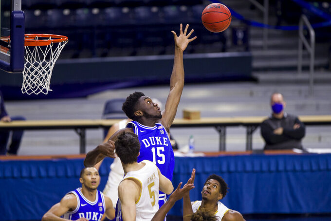 Duke's Mark Williams (15) reaches to deflect a shot during the second half of an NCAA college basketball game against Notre Dame on Wednesday, Dec. 16, 2020, in South Bend, Ind. Duke won 75-65. (AP Photo/Robert Franklin)
