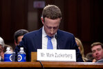 "FILE - In this April 10, 2018, file photo Facebook CEO Mark Zuckerberg looks down as a break is called during his testimony before a joint hearing of the Commerce and Judiciary Committees on Capitol Hill in Washington. Twitter's ban on political advertising is ratcheting up the pressure on Facebook and Zuckerberg to follow suit. Zuckerberg doubled down on Facebook's approach in a call with analysts Wednesday, Oct. 30, 2019, he reiterated Facebook's stance that ""political speech is important."