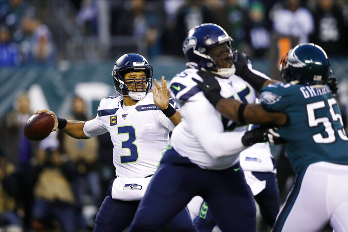 Seattle Seahawks' Russell Wilson passes during the first half of an NFL wild-card playoff football game against the Philadelphia Eagles, Sunday, Jan. 5, 2020, in Philadelphia. (AP Photo/Matt Rourke)