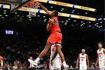 Auburn center Austin Wiley (50) dunks during the second half of an NCAA college basketball game against New Mexico in the Legends Classic, Monday, Nov. 25, 2019, in New York, as New Mexico guards Makuach Maluach (10), JJ Caldwell (11) and Tavian Percy (4) watch from the floor. Auburn defeated New Mexico 84-59. (AP Photo/Kathy Willens)