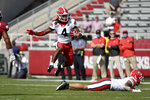 Georgia running back James Cook (4) jumps over a teammate during the first half of an NCAA college football game against Arkansas in Fayetteville, Ark., Saturday, Sept. 26, 2020. (AP Photo/Michael Woods)