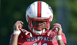 In this photo taken Thursday, Aug. 9, 2018 North Carolina State wide receiver Jacobi Meyers starts on his helmet during an NCAA college football practice in Raleigh, N.C. (AP Photo/Gerry Broome)