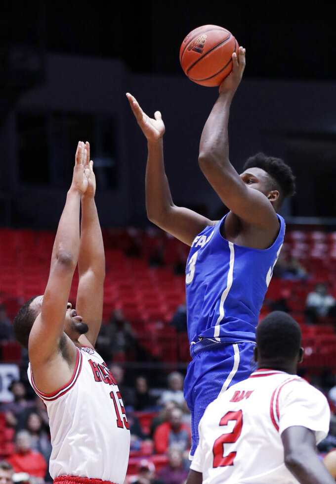 Buffalo forward Nick Perkins, right, shoots over Northern Illinois forward Jaylen Key during the first half of an NCAA college basketball game Tuesday, Jan. 22, 2019, in DeKalb, Ill. (AP Photo/Nam Y. Huh)