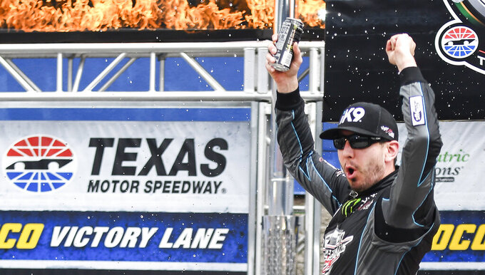 Driver Kyle Busch celebrates in victory lane after winning a NASCAR auto race at Texas Motor Speedway, Saturday, March 30, 2019, in Fort Worth, Texas. (AP Photo/Randy Holt)