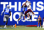 Mississippi State wide receiver Makai Polk (10) jumps up to make a catch over Memphis players during an NCAA college football game Saturday, Sept. 18, 2021, in Memphis, Tenn. (Patrick Lantrip/Daily Memphian via AP)