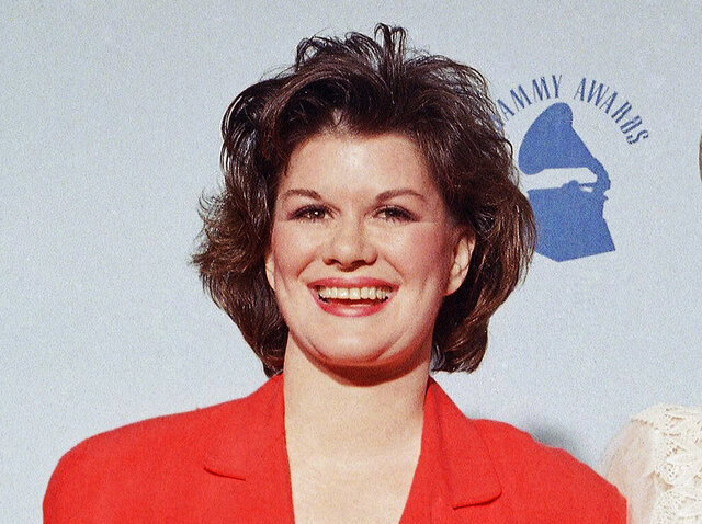 "FILE -  K.T. Oslin appears at the  31st Annual Grammy Awards in Los Angeles on Feb. 23, 1989. Oslin, who hit it big with the 1987 hit ""80′s Ladies"" and won three Grammy awards, has died. She was 78. (AP Photo/Douglas C. Pizac, File)"