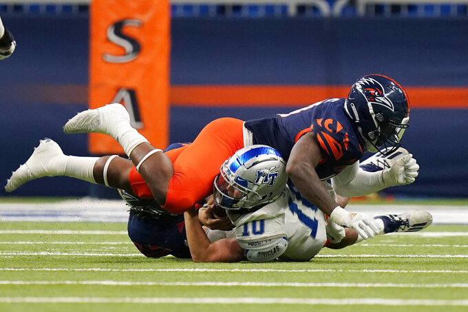 Middle Tennessee quarterback Asher O'Hara (10) is sacked by UTSA defensive lineman Trumane Bell II (49) during the second half of an NCAA college football game Friday, Sept. 25, 2020, in San Antonio. (AP Photo/Eric Gay)