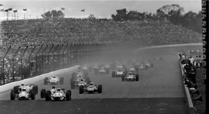 "FILE - In this May 30, 1967, file photo, Mario Andretti (1) leads the field at the start of the 51st running of the Indianapolis 500 at Indianapolis Motor Speedway in Indianapolis. The race had to be stopped for rain, and was restarted the following day. Gordon Johncock (3), far left, and  A.J. Foyt (14), center, the eventual race winner, also compete. When it came to deciding the greatest rivalry, Foyt, Andretti and Bobby Unser received the most attention. 1986 winner Bobby Rahal says ""the greatest rivalry had to be A.J. Foyt against anyone else."" (AP Photo, File)"
