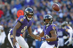 Baltimore Ravens quarterback Lamar Jackson, left, and running back Kenneth Dixon chase after a loose ball in the first half of an NFL wild card playoff football game against the Los Angeles Chargers, Sunday, Jan. 6, 2019, in Baltimore. (AP Photo/Carolyn Kaster)