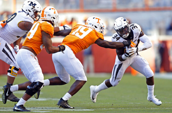 Missouri running back Larry Rountree III (34) tries to escape from Tennessee linebacker Darrell Taylor (19) in the first half of an NCAA college football game Saturday, Nov. 17, 2018, in Knoxville, Tenn. (AP Photo/Wade Payne)