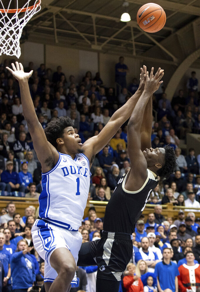 Wofford's Chevez Goodwin, right, attempts a shot as Duke's Vernon Carey Jr. defends during the first half of an NCAA college basketball game in Durham, N.C., Thursday, Dec. 19, 2019. (AP Photo/Ben McKeown)