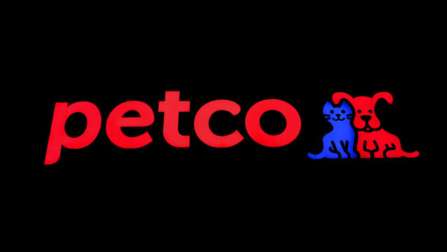 FILE - This Nov. 12, 2018 file photo hows a store sign at a Petco store in Chicago.  Petco, the San Diego-based pet store chain, went public again Thursday, Jan. 14, 2021 hoping to bank on people's obsession with their furry friends.  Petco's stock, which opened at $18 Thursday, rose 66% to $29.89 in afternoon trading, valuing the company at more than $6 billion.   (AP Photo/Kiichiro Sato, File)