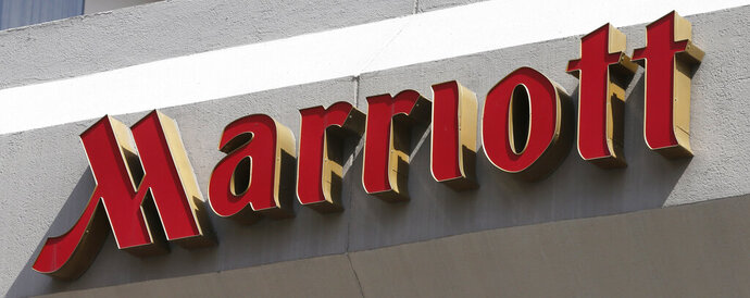 FILE - This Wednesday, March 23, 2016, file photo, shows a sign at a Marriott Hotel in Richmond, Va. Marriott says it will fight a $123 million U.K. government fine related to its massive data breach. (AP Photo/Steve Helber, File)