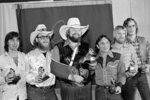 FILE - Charlie Daniels, center, joins members of the Charlie Daniels Band with their Grammy Awards in Los Angeles on Feb. 27, 1980, as best country vocal performance by a group for their hit