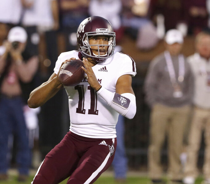 Texas A&M quarterback Kellen Mond (11) looks for a receiver down-field during the first half of their NCAA college football game against Mississippi State on Saturday, Oct. 27, 2018, in Starkville, Miss. (AP Photo/Jim Lytle)