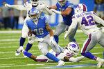 Detroit Lions running back Craig Reynolds rushes past Buffalo Bills linebacker Joe Giles-Harris (42) during the second half of a preseason NFL football game, Friday, Aug. 13, 2021, in Detroit. (AP Photo/Paul Sancya)