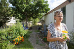 In this Sept., 4, 2019 photo Mobile home resident Linda Biggs walks near her home at Canyon Country mobile home park in Canon City, Colo., Some Colorado towns are taking action to preserve their remaining mobile home parks. Cities, counties and housing authorities, such as the Yampa Valley Housing Authority in Steamboat Springs, are buying mobile home parks to preserve affordable housing for residents as other mom-and-pop park owners sell out to developers or investors. (Jeremy Sparig/The Colorado Sun Via AP)