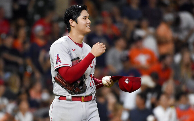 Los Angeles Angels starting pitcher Shohei Ohtani reacts after an RBI-double by Houston Astros' Yordan Alvarez during the third inning of a baseball game, Friday, Sept. 10, 2021, in Houston. (AP Photo/Eric Christian Smith)