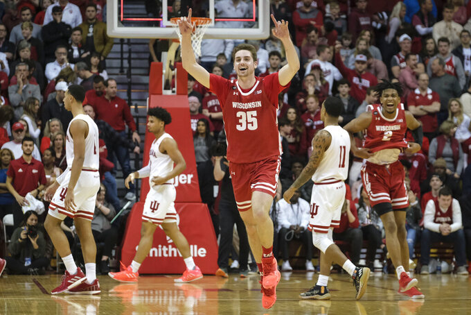Wisconsin forward Nate Reuvers (35) reacts after defeating Indiana 60-56 in an NCAA college basketball game in Bloomington, Ind., Saturday, March 7, 2020. (AP Photo/AJ Mast)