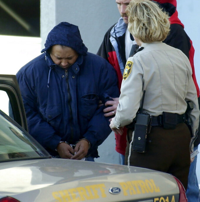 FILE - In this Dec. 3, 2003 file photo, Alfonso Rodriguez Jr., left, is helped into a sheriff's car after waiving extradition at the Polk County Courthouse in Crookston, Minn. North Dakota's first and only federal capital punishment case is on hold after a federal judge earlier this month threw the death sentence given Alfonso Rodriguez Jr. in 2006 in the death of college student Dru Sjodin. (AP Photo/Ann Heisenfelt File)
