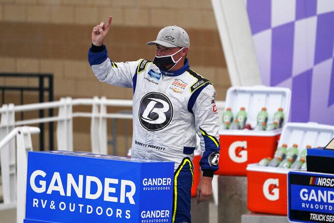 Brett Moffitt celebrates in victory lane following a NASCAR Truck Series auto race at Kansas Speedway in Kansas City, Kan., Saturday, Oct. 17, 2020. (AP Photo/Orlin Wagner)